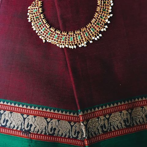 56b303c629 Chettinad cotton saree featuring elephant motifs • Three colors • First is  a deep maroon body