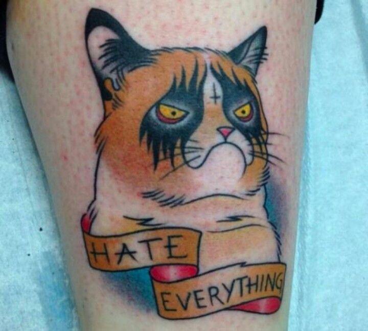 Grumpy metal cat tattoo