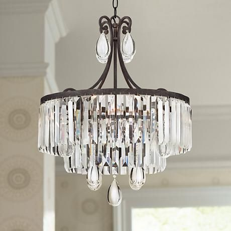 timeless lighting. clear crystal prisms and drops shine in the light of this timeless bronze finish 4 lighting t