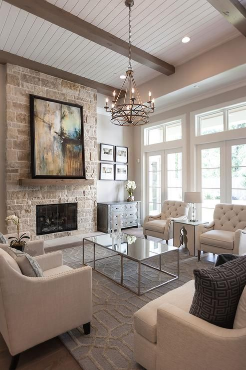 Beautiful living room features a ceiling lined with taupe wood beams
