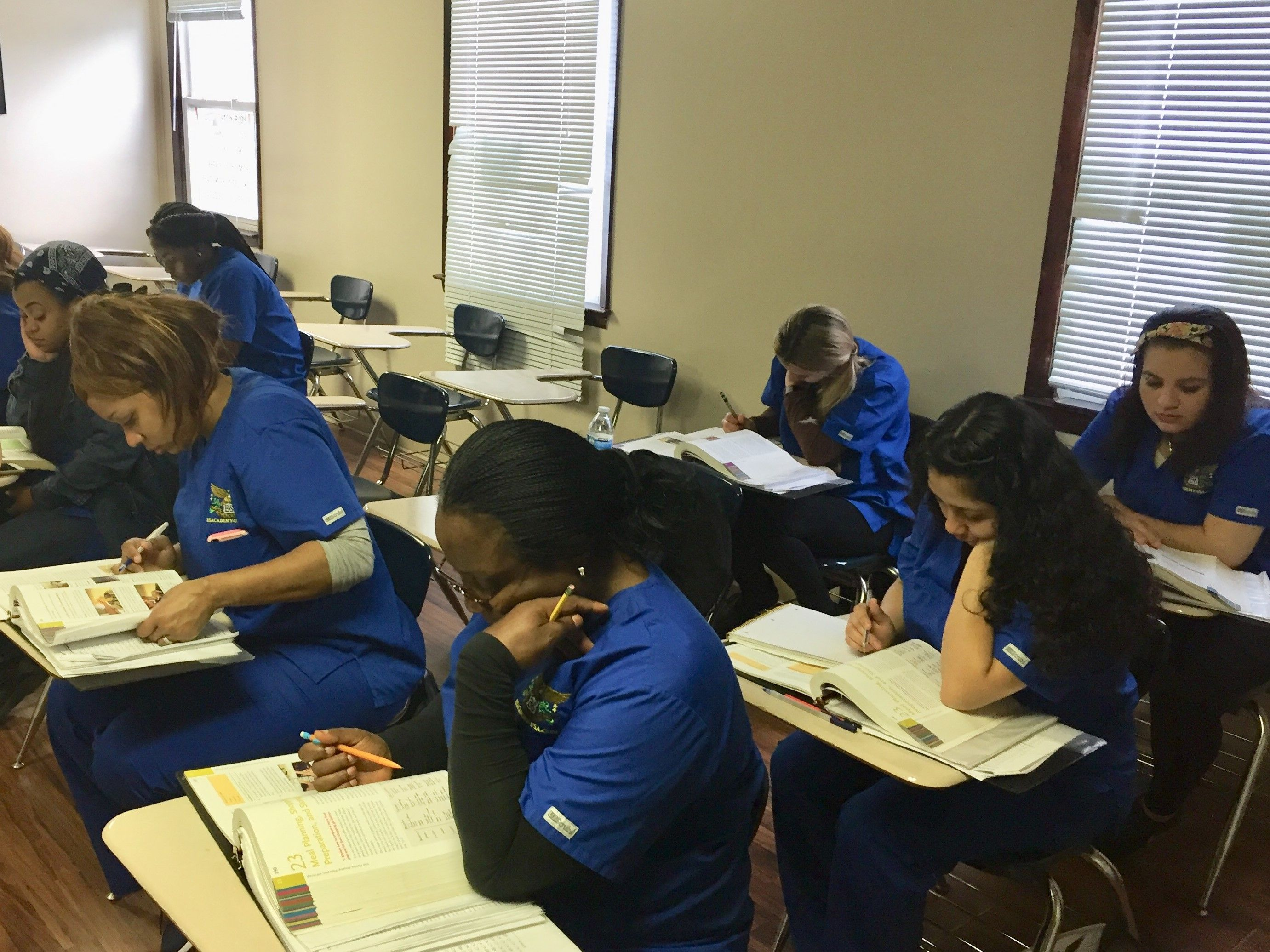 Home Health Aide Student S Acting Studious In The Classroom Hha Textbooks Hardworking Blueuniforms Train Home Health Aide Vocational School Home Health