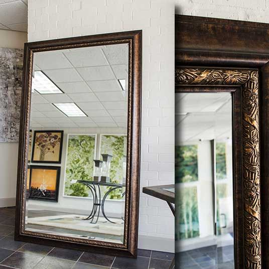 A large floor mirror with an espresso colored frame the for Framed floor mirror