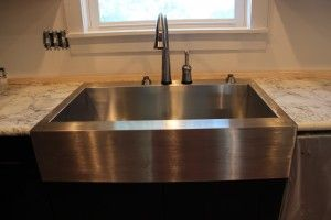 Kohler Vault Apron Front Sink With A Delta Pilar Faucet With Touch