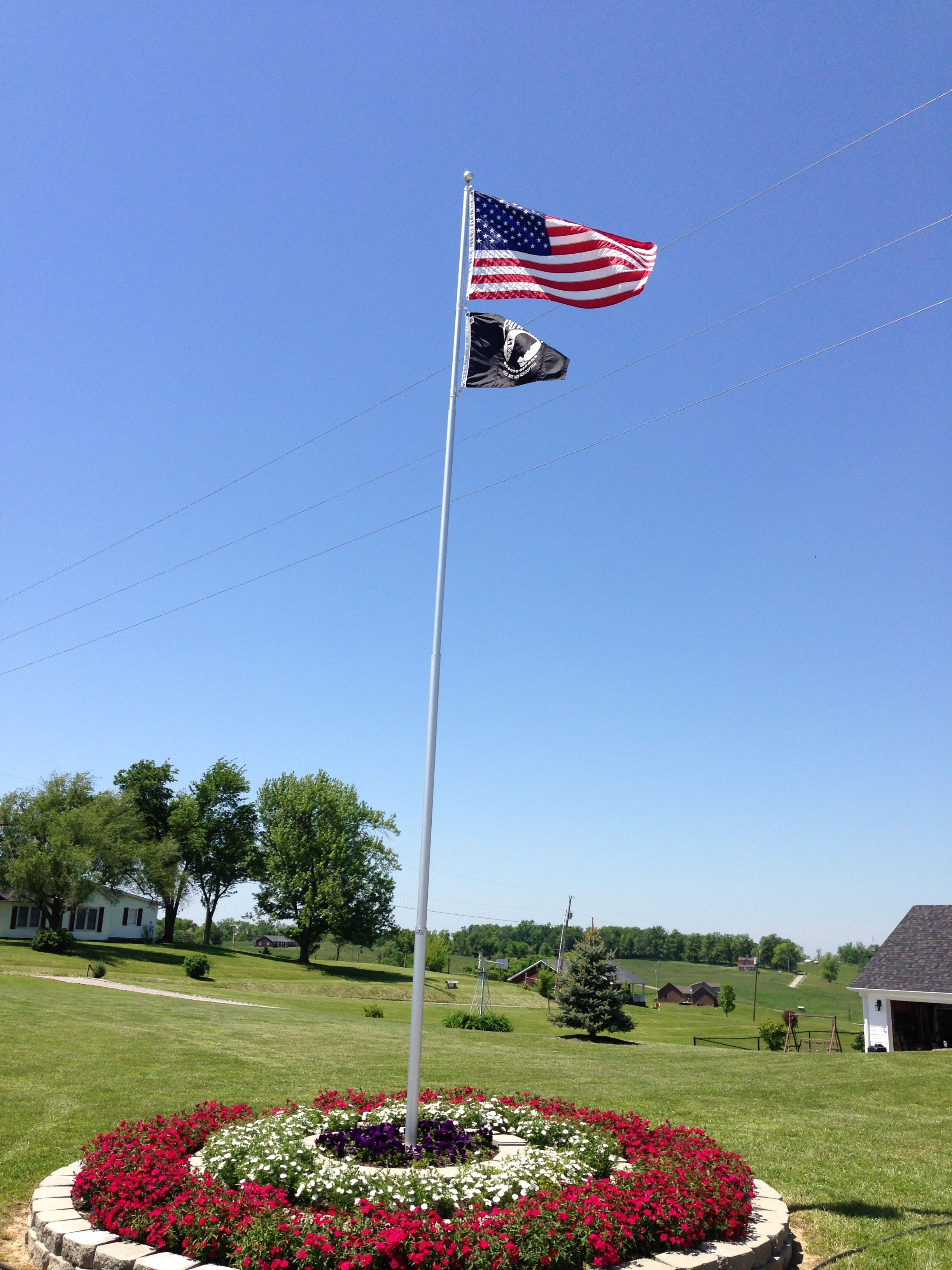 flag pole. pole landscaping