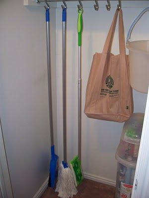 S Hooks To Hang Mops And Brooms In The Closet Utility Closet