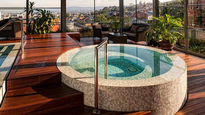 Raised Circular Spa With Mosaic Tile And Infinity Edge