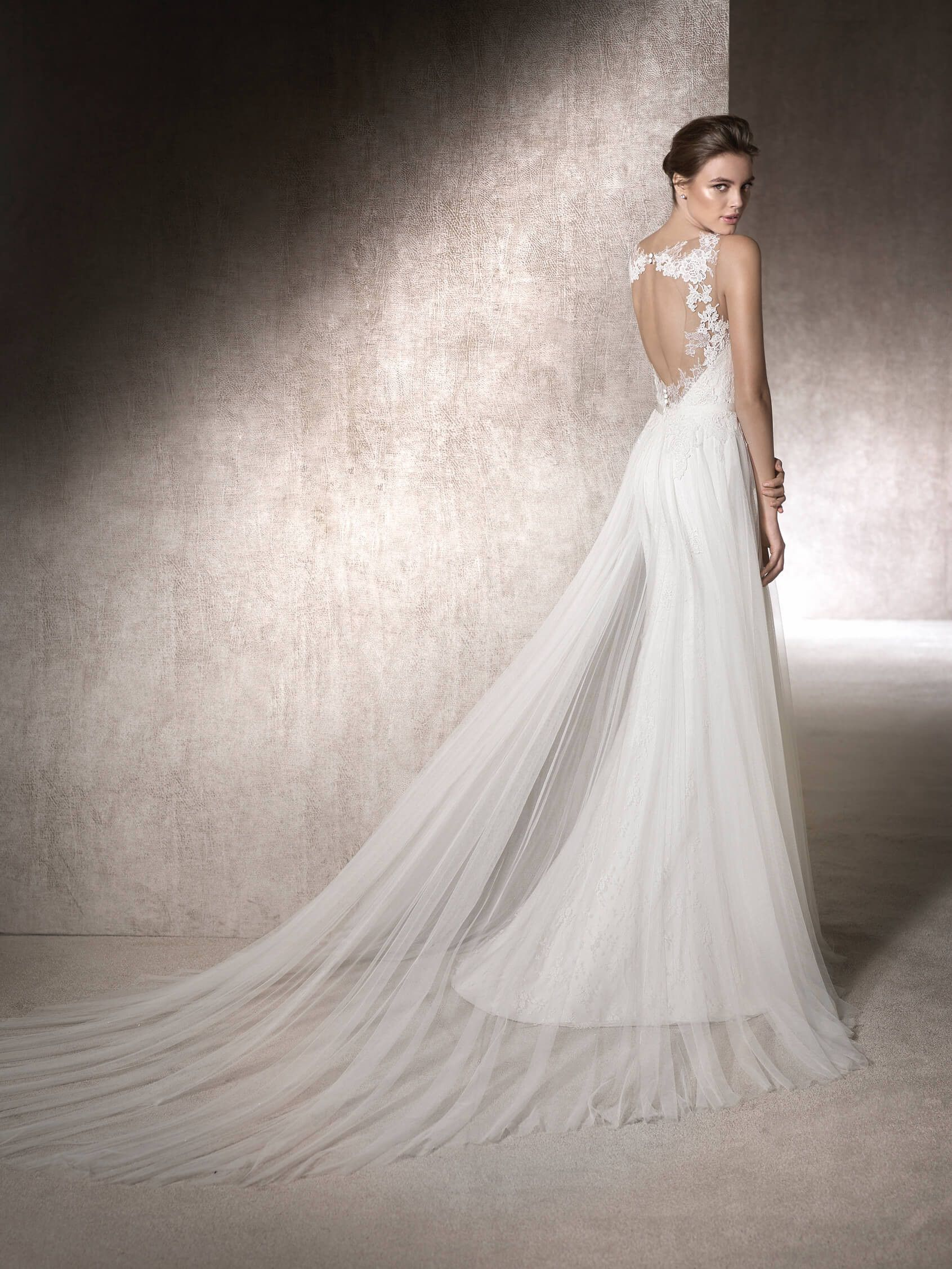 Monica is a flared wedding dress in soft tulle chantilly and
