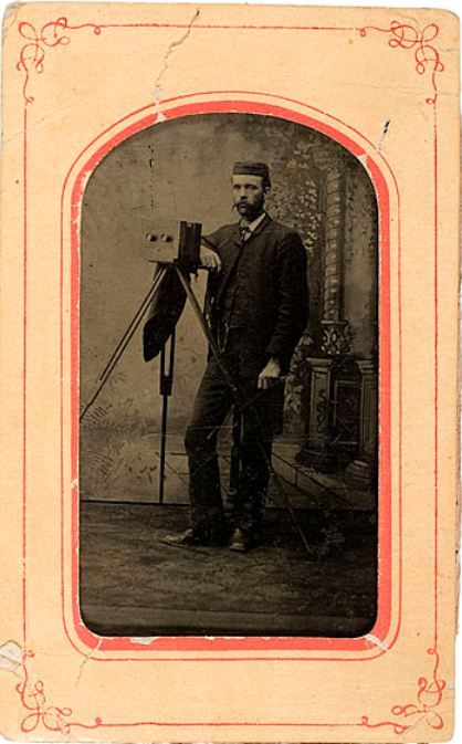 ca. 1880-90's, tintype portrait of a gentleman with his stereoview camera
