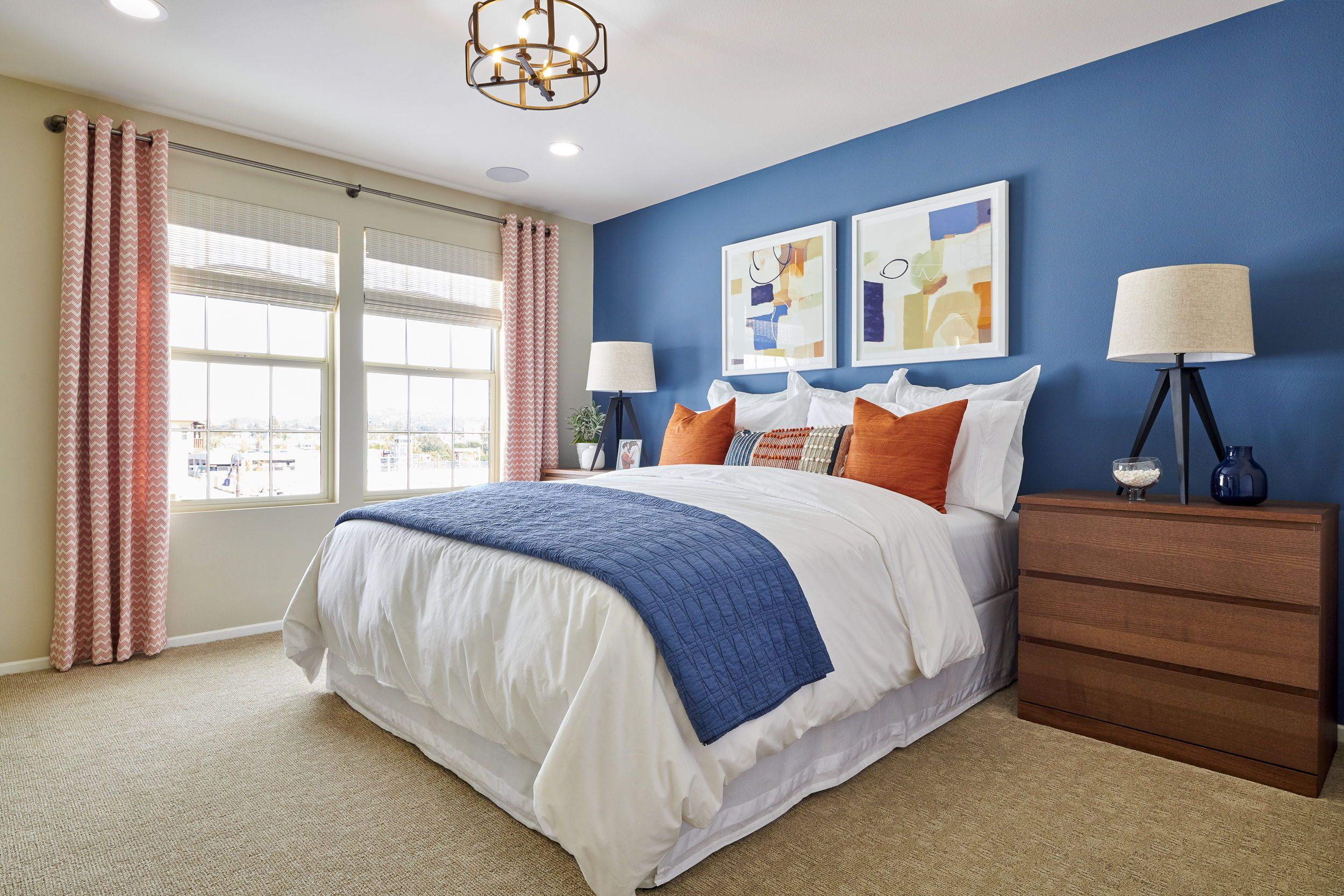Blue accent paint in this guest bedroom adds a striking ...