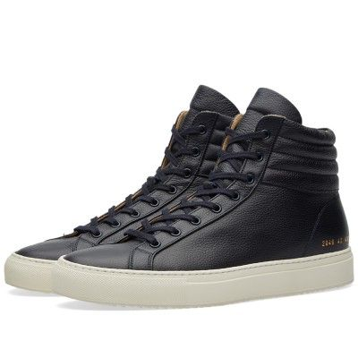 Continuing their quiet revolution on the world of overly branded footwear, the Achilles High is one of Common Projects' true signature styles. For the latest collection the brand rework the model with a truly premium edge; crafting the sneaker's uppers in a luxury full grain leather. The sneaker's upper is kitted out in tonal laces and eyelets, all sitting atop an off-white rubber cup sole.  Grain Leather Uppers Leather Lined Gold Stamped Branding Rubber Cup Sole Unit Made In Ital...