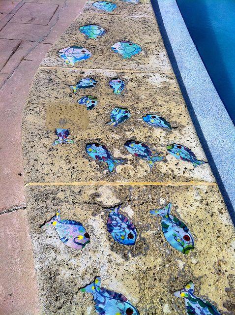 Ceramic painted fish poolside