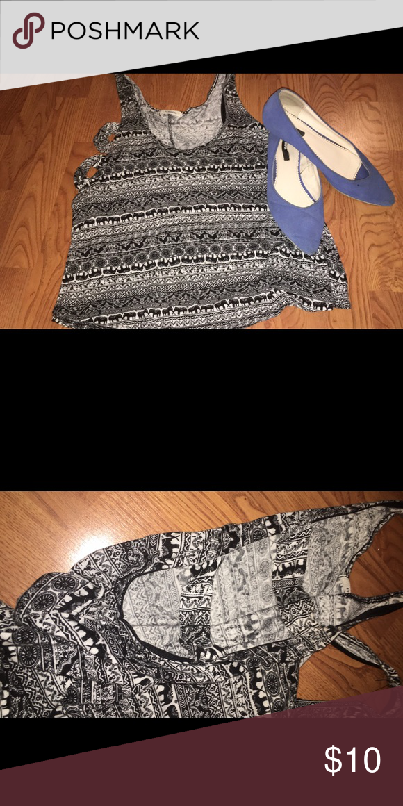 Cut Out Tank🐘🐘 Adorable tank! 🐘🐘🐘 worn only a couple times. Not forever 21 but it has a very similar style! Fits a M/L ❤️from my personal closet❤️  ⚡️⚡️⚡️ Feel free to make offers! BOGO $10 & under items if you let me know before purchasing. Forever 21 Tops Tank Tops