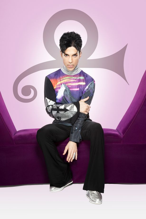 Prince completing his symbol. Since about 1990, Prince had always reflected the symbol physically with a combination of hair style and facial hair, i.e. beards, mustache's. You just have to look closely, like here, he's crossing his arm, and completing the arrow with his left arm and hand.