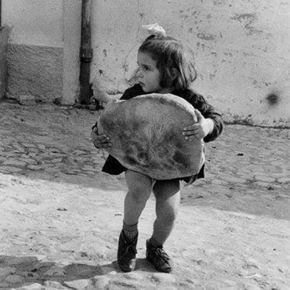 Carrying the bread home