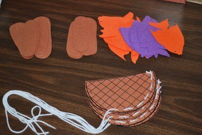and fishes craft -- would be good laminated (no yarn lacing) and adding some sort of place to name the dish brought on loaves & fishes Sunday (@Christa Cross)