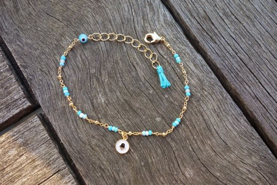 Blue Seed Beaded Bracelet with Gold Hamsa Charm Evil por cocolocca