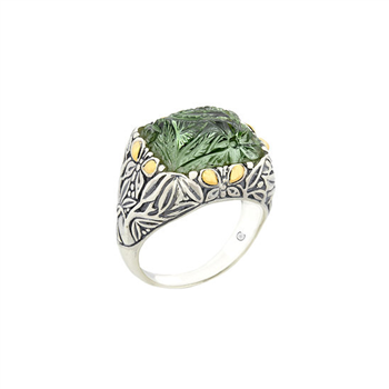 Peridot ring set in sterling silver and 18k yellow gold