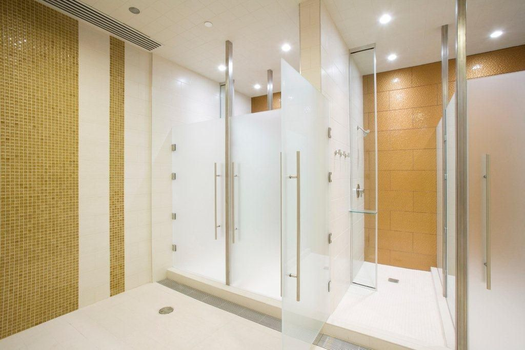 Modono Glass Panels Used As For High End Shower In Equinox Gym