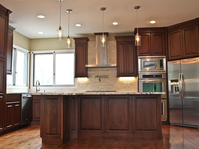 formal kitchen clear poplar with a dark walnut stain molner homes