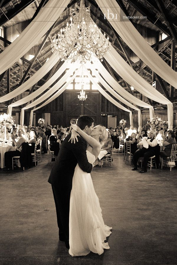 chandeliers with draping transforms this barn into a beautiful venue