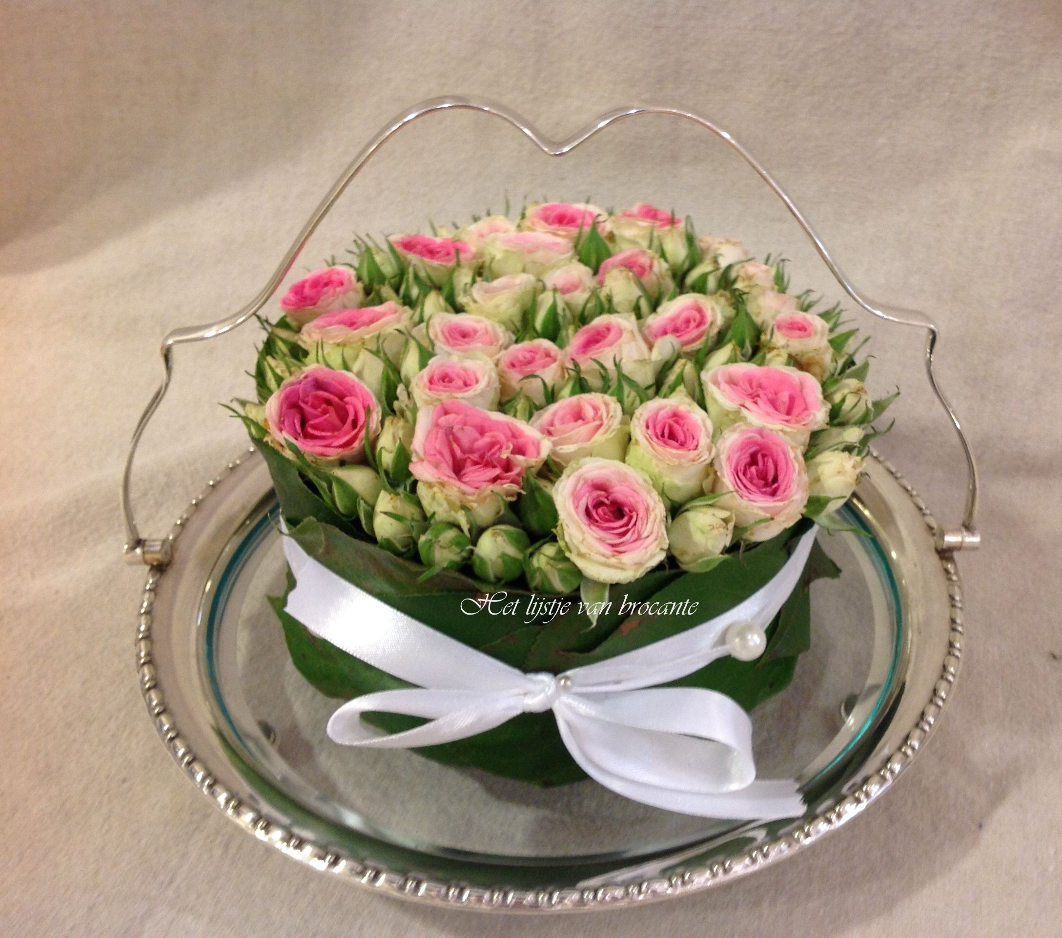 English silver plated cakestand with homemade flower cake.