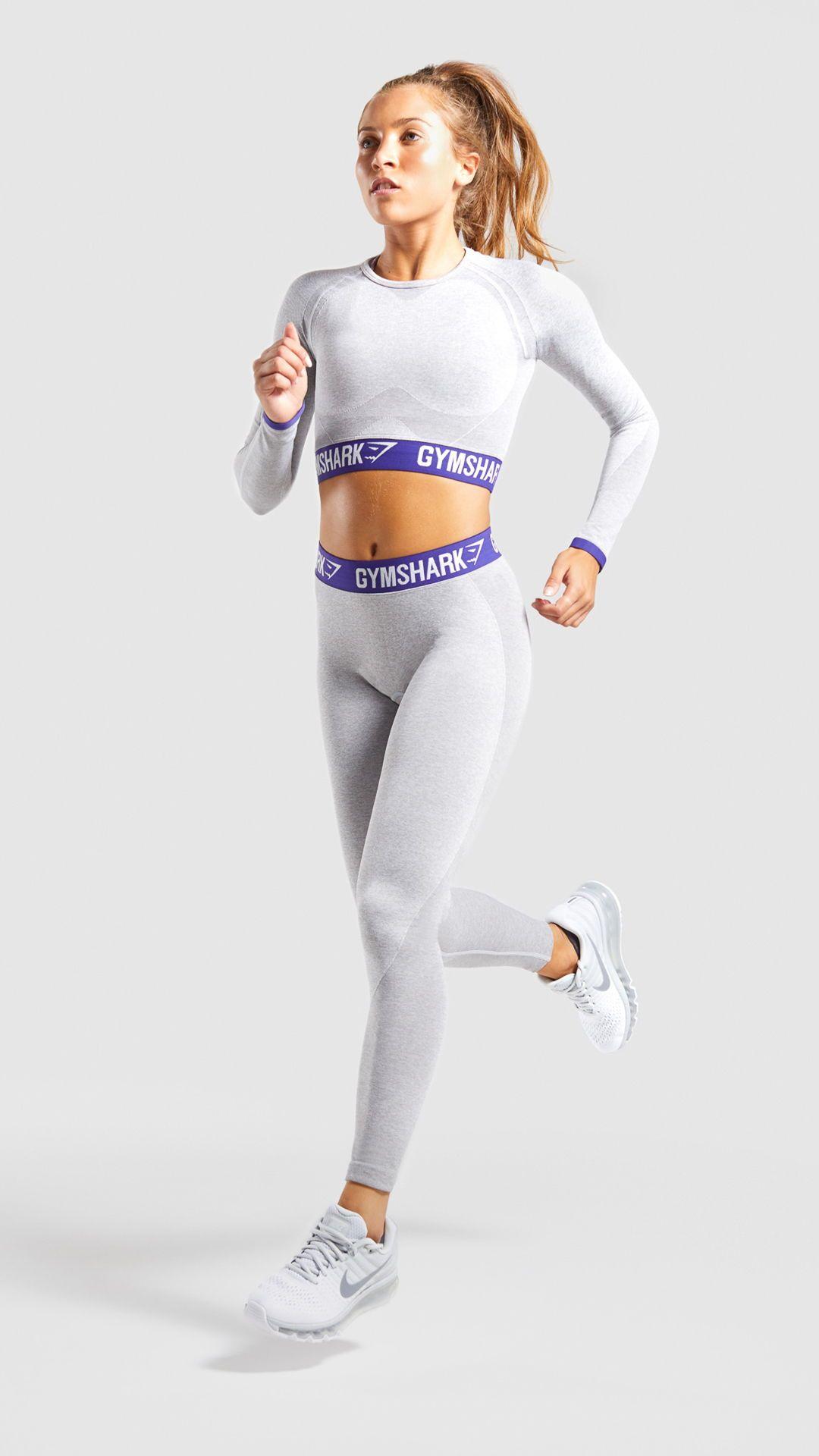 05332f2653e38 The Gymshark Flex Long Sleeve Crop Top, Light Grey Marl/ Indigo. Our model  is 5