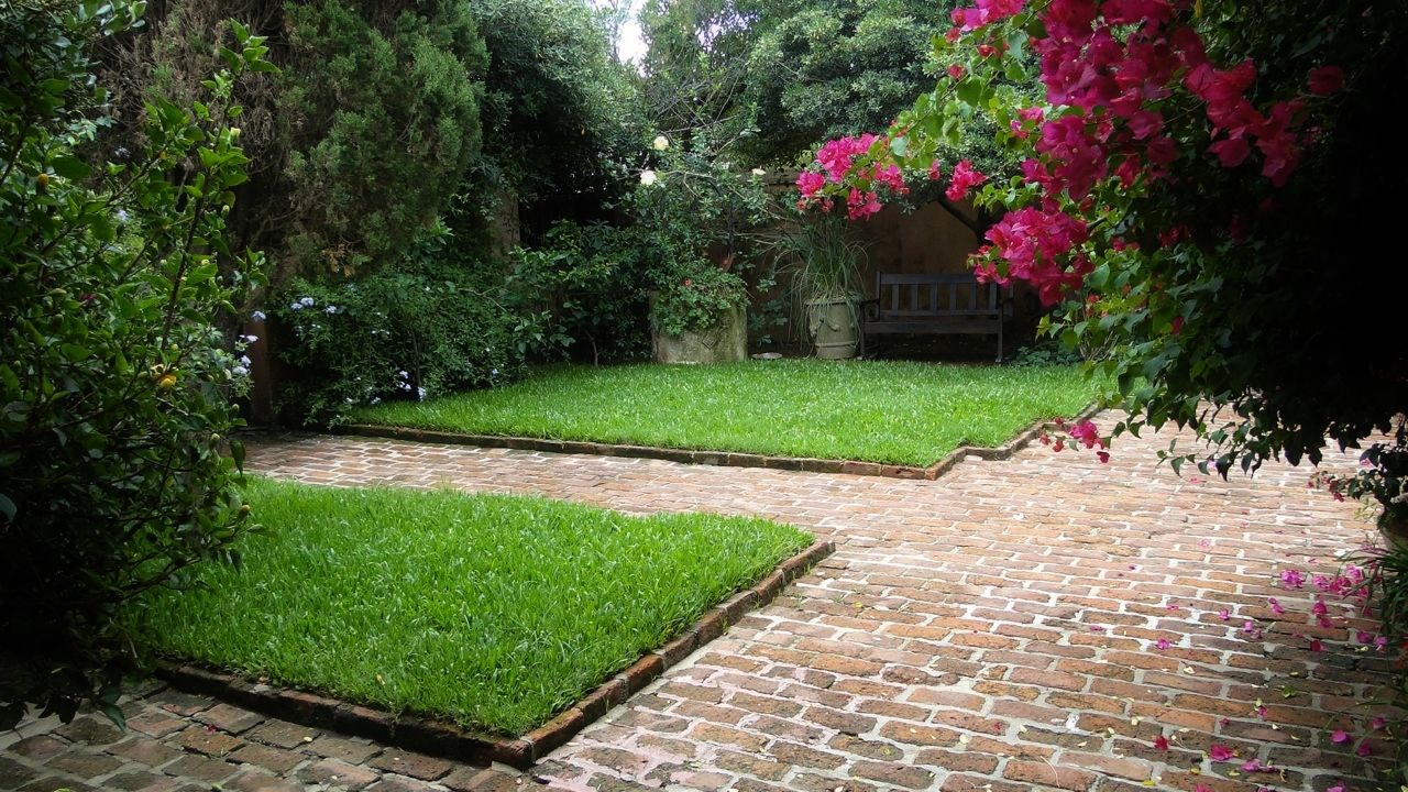 grass - brick paver combination  courtyard by patricia malmierca landscape arch