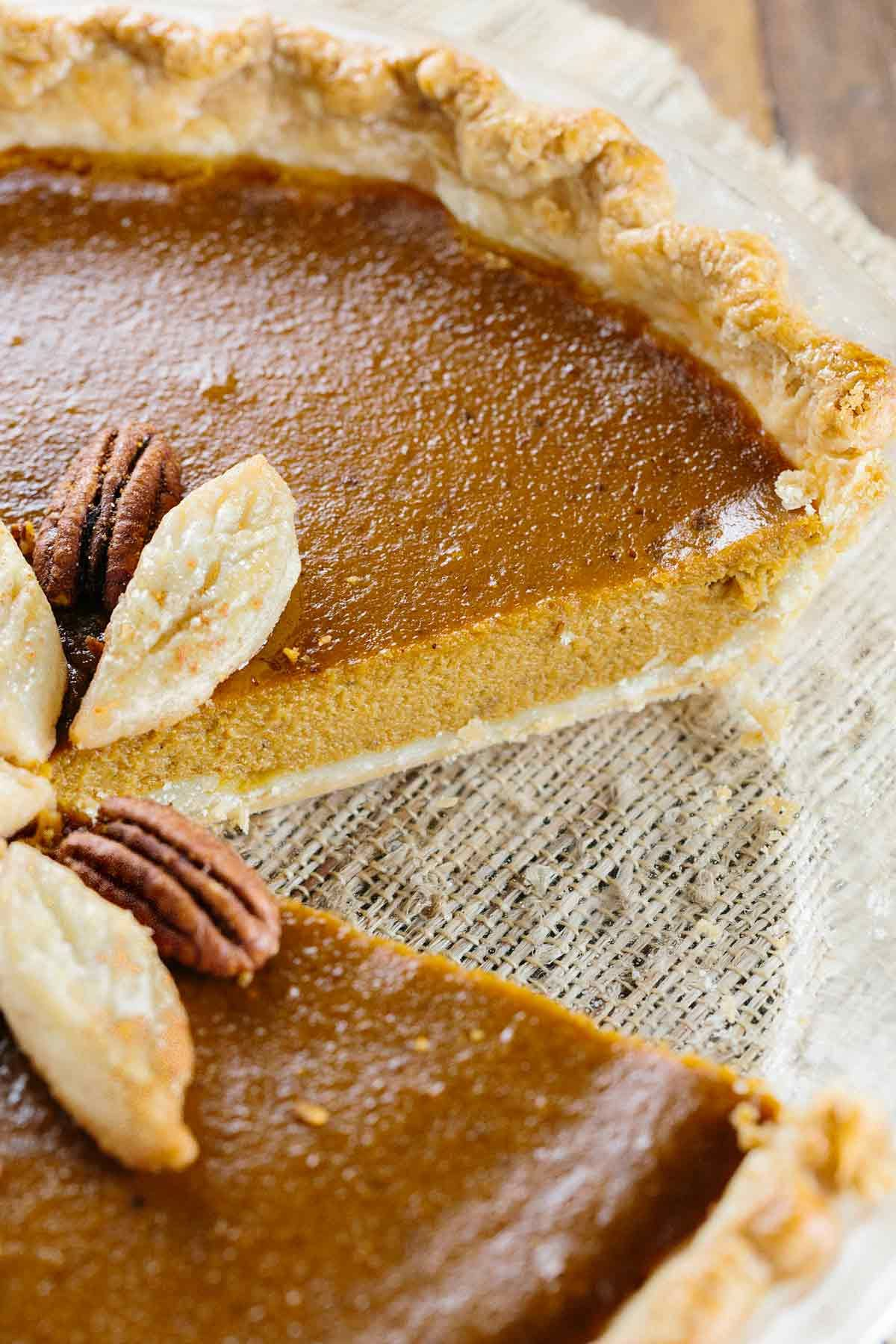 The Best Classic Pumpkin Pie Recipe - Traditional spices of cinnamon, nutmeg, ginger, cloves and black pepper are infused in the creamy pumpkin custard and baked in an incredibly flaky and tender crust! | jessicagavin.com