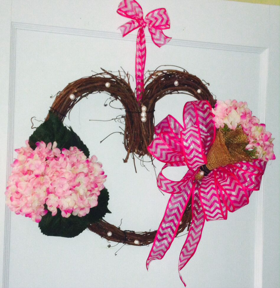 Valentines day wreath accented with a nosegay of pink hydrangea's and pearls.