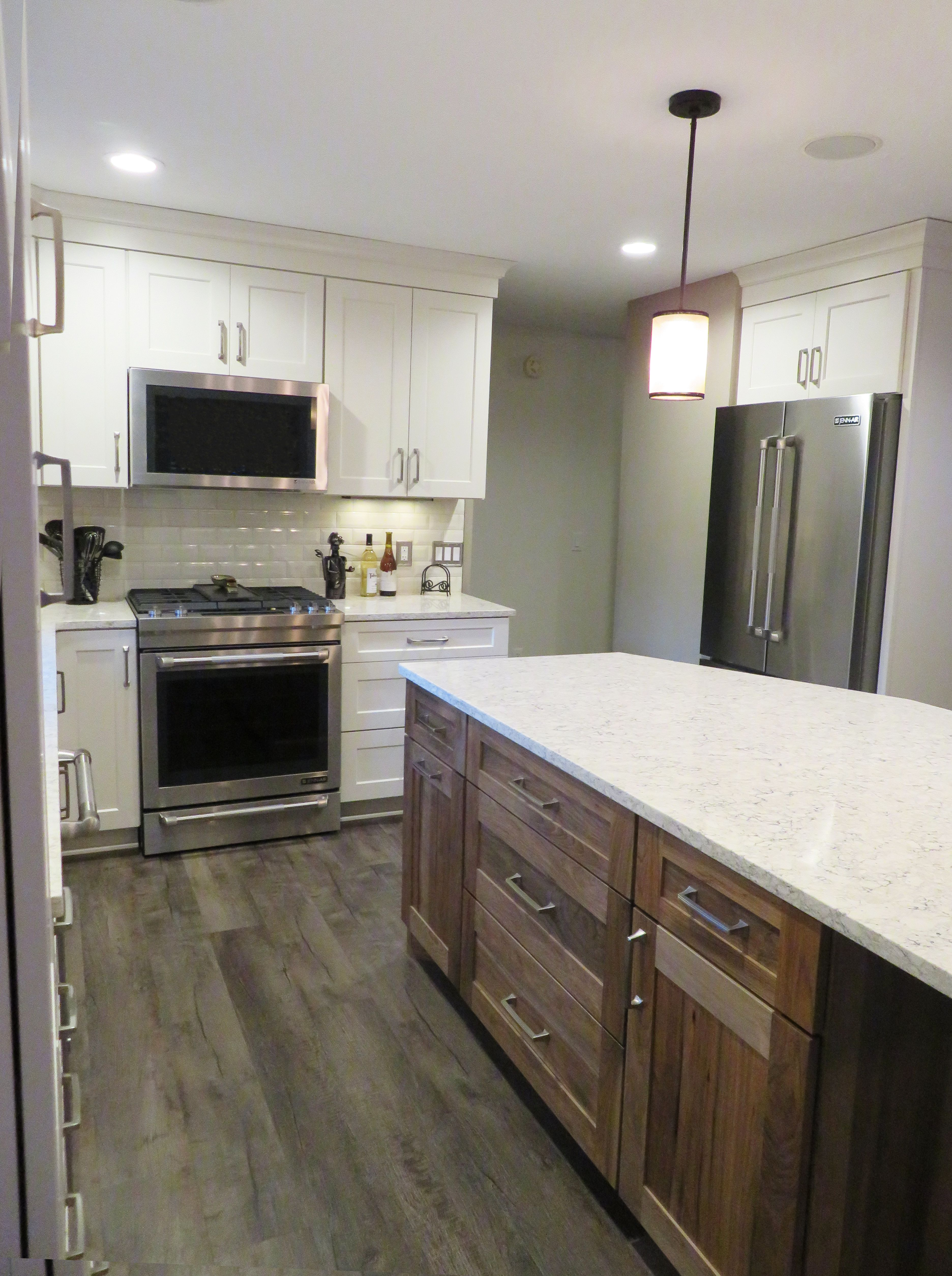 This gorgeous kitchen is made up of cabinetry woodland cabinetry creme and island is mission hickory in natural countertops lg in aria flooring fusion lvt sully backsplash daltile rittenhouse 3x6 beveled subway tile doublecrazyfo Image collections