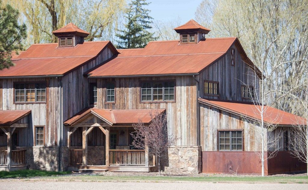 Weathered Grey Hardwood Barn Siding With Shiplapped Milled Profiles Give This Home S Siding A Tight Fitting Authentic Barn W Wood Siding Exterior House Exterior