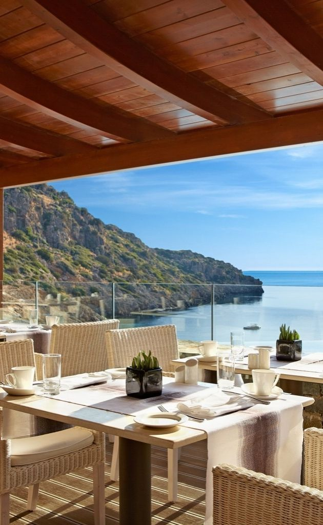 Hand-carved out of the surrounding hillside above the inviting azure waters of Daios Bay