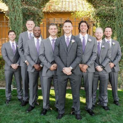 Groom and groomsmen in grey tuxedos and light purple ties ...