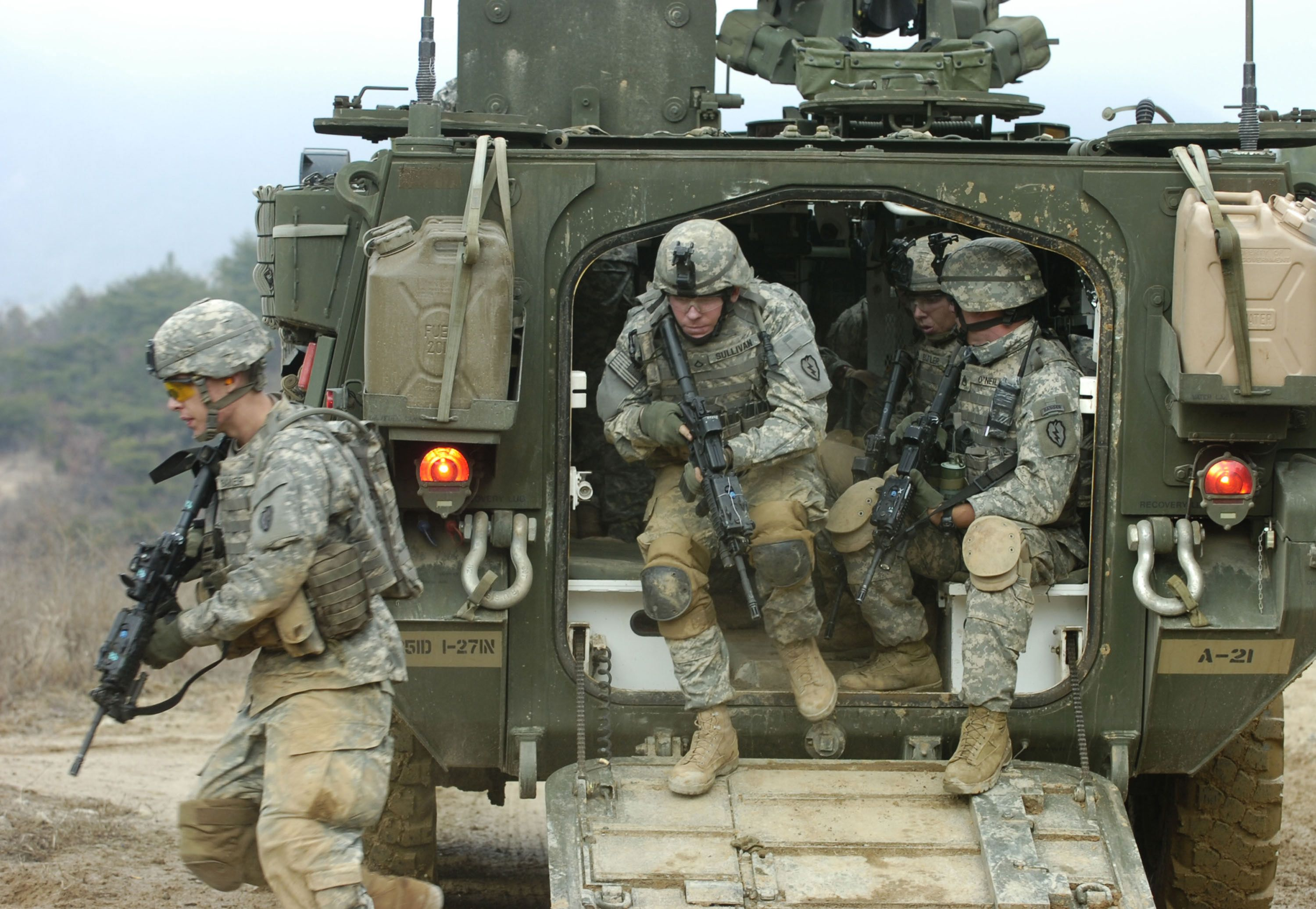 U S Army Soldiers From Alpha Company 1st Battalion 27th Infantry Regiment 2nd Stryker Brigade Combat Team Exit Their M1126 Stryker In Us Army Army Military