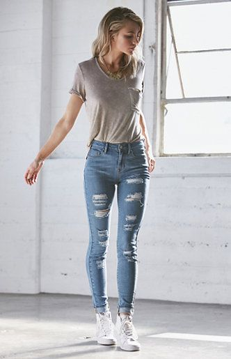 The Tally Blue Ripped High Rise Skinny Jeans feature destructed details and  a medium indigo wash. These jeans boast an ultra slim construction and our  ... 00f2f0823