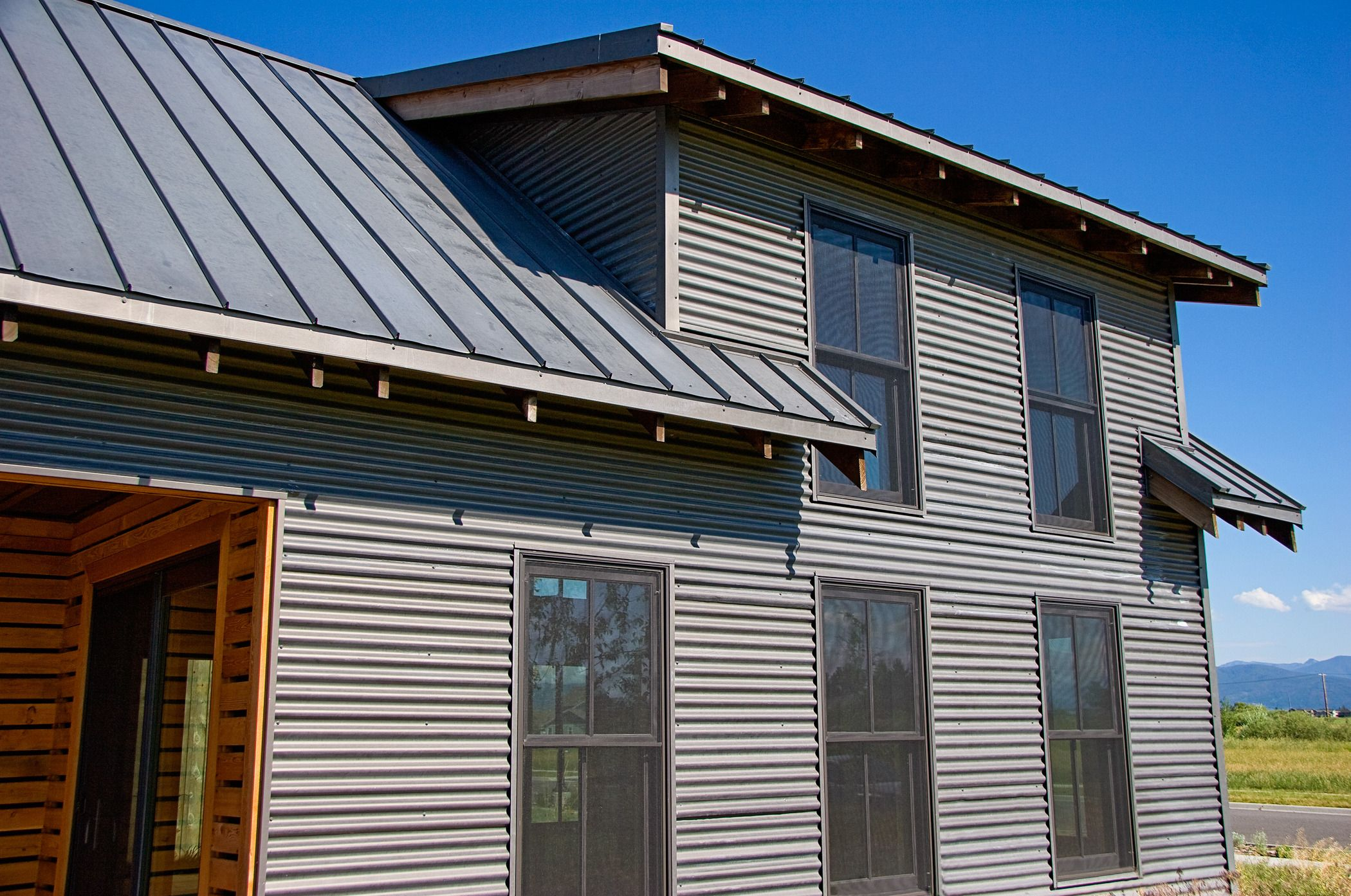 Bonderized siding and roofing exterior pinterest for Images of houses with metal roofs