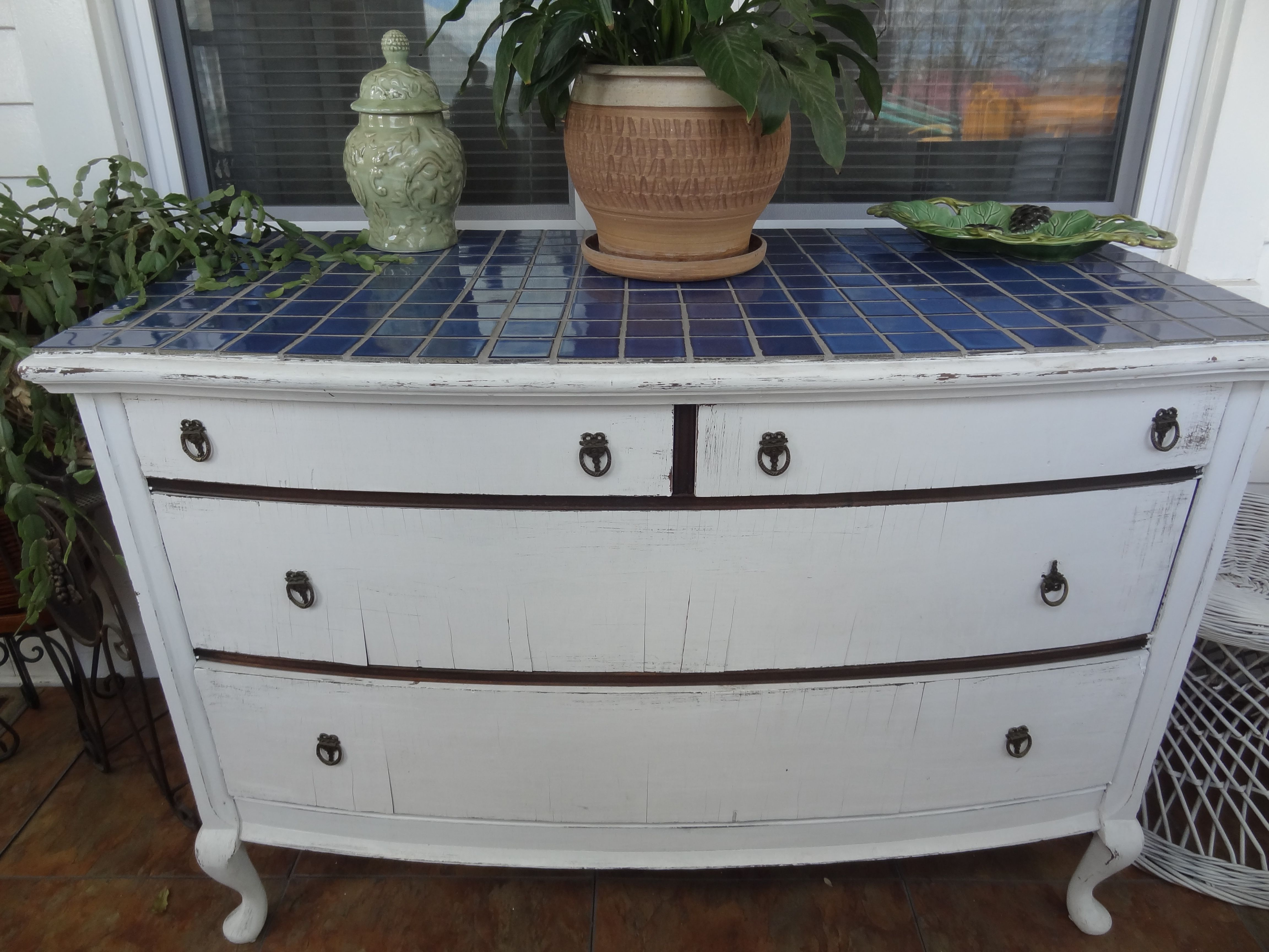 distressed dresser with ceramic tiles