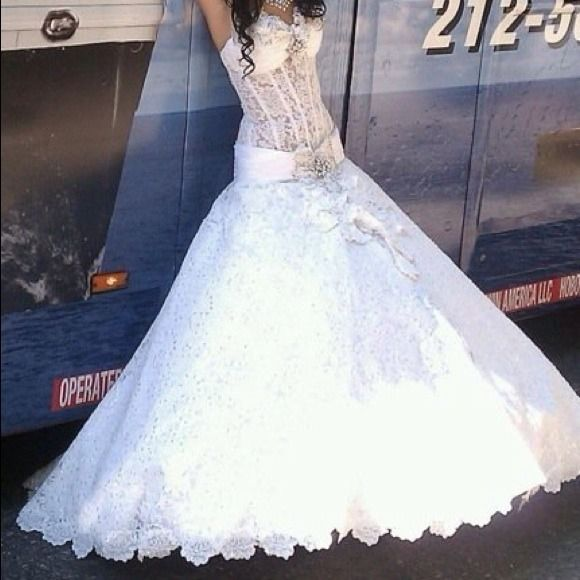 Wedding dress made with Swarovski crystals. The dress is a size 0-2 Swarovski  crystals all over the dress Innataly boutique  Dresses