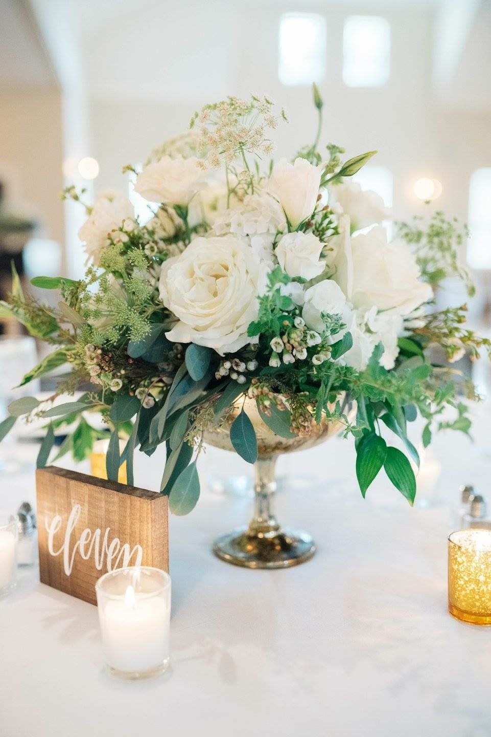 Green, white, and gold wedding florals