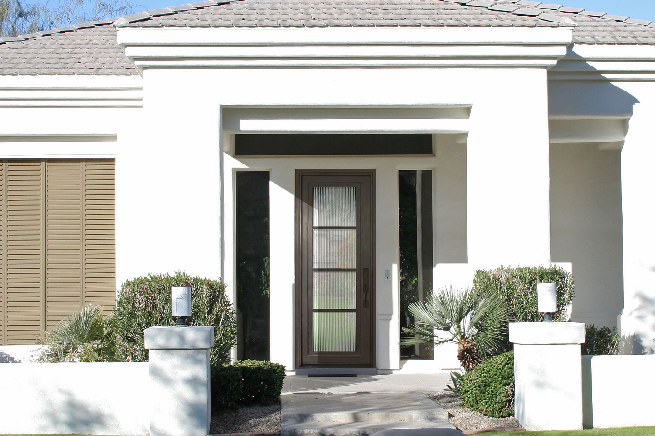 GlassCraft's new WP steel door design on a contemporary home exterior.