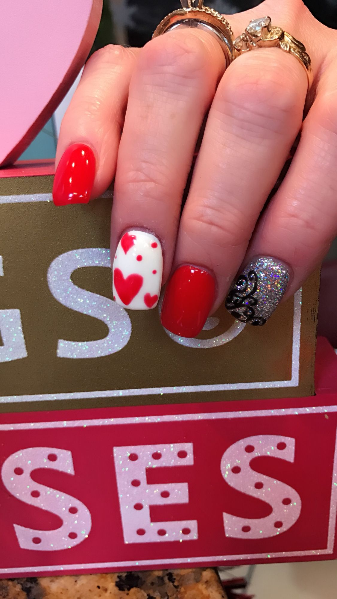 Hand painted heart by Rosy Doan Nail salon and spa