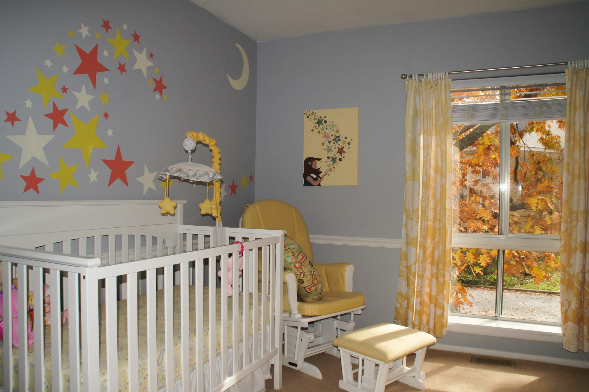 Our daughter's nursery is finally finished!  Gray, yellow, and white color scheme. We used stars as our general theme.