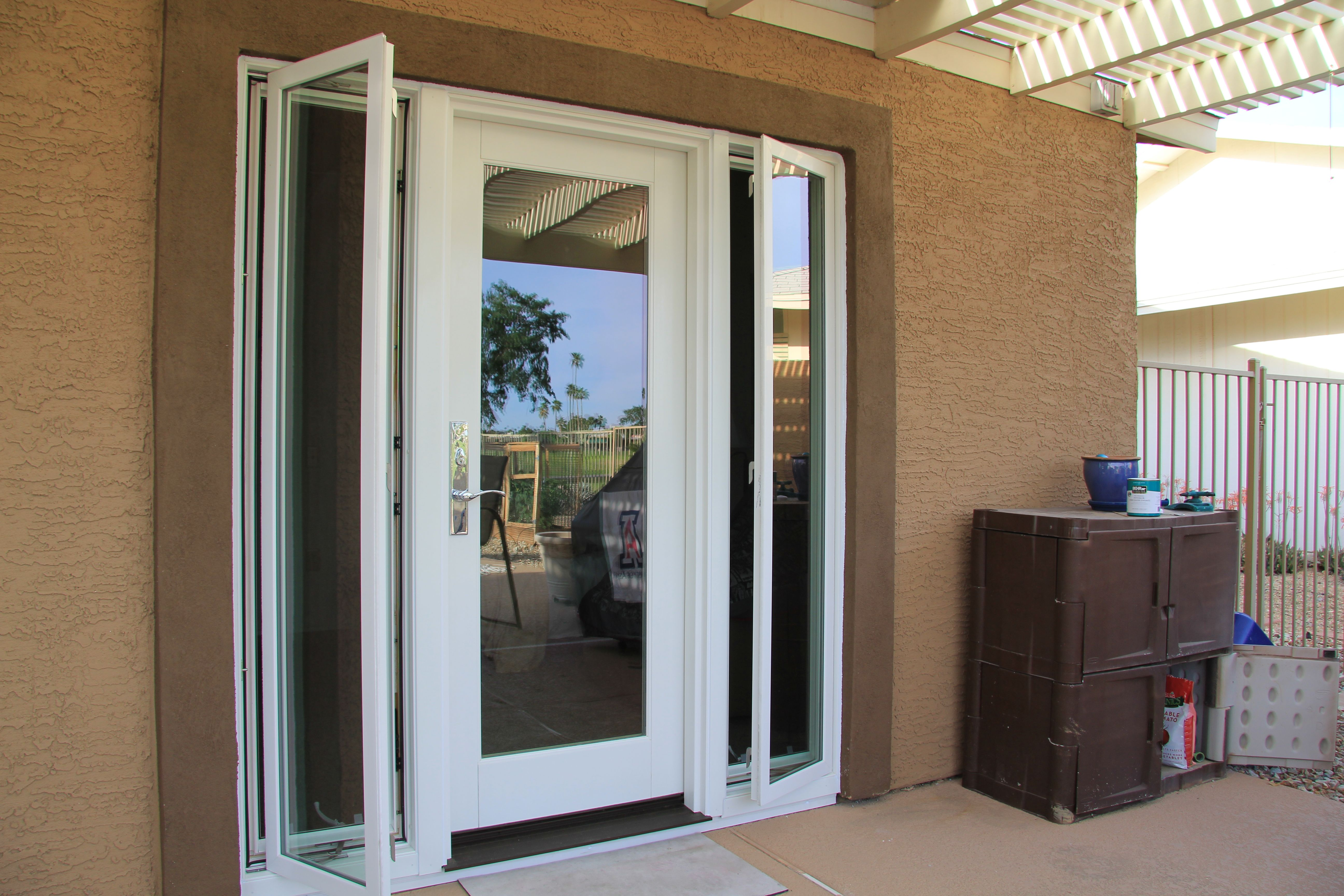 A Single French Door With Two Operating Casement Window Sidelights