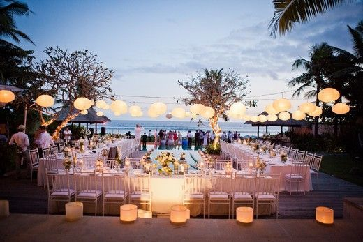 Around The Poolside Wedding Dinner Reception With Use Of String Lights Lanterns And LED