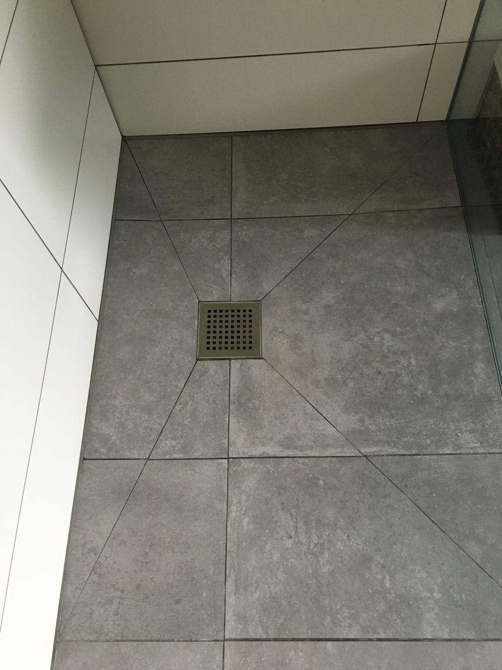 Wet room shower floor with diagonal cuts. #wetrooms