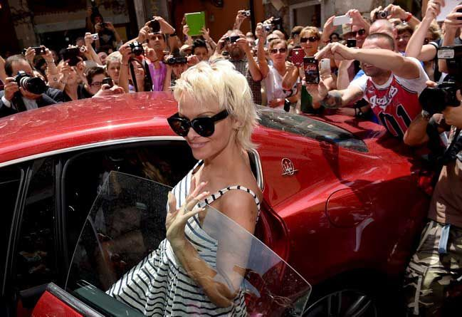 Pamela Anderson #PamelaAnderson @Maserati #Maserati In the exciting Taormina city arriving new stars in the much admired Maserati Quattroporte and Ghibli