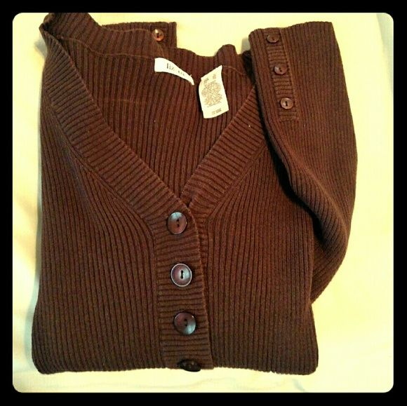 V Neck Ribbed Sweater. Classic fall sweater, buttons halfway down the front and on sleeves. Sweaters V-Necks