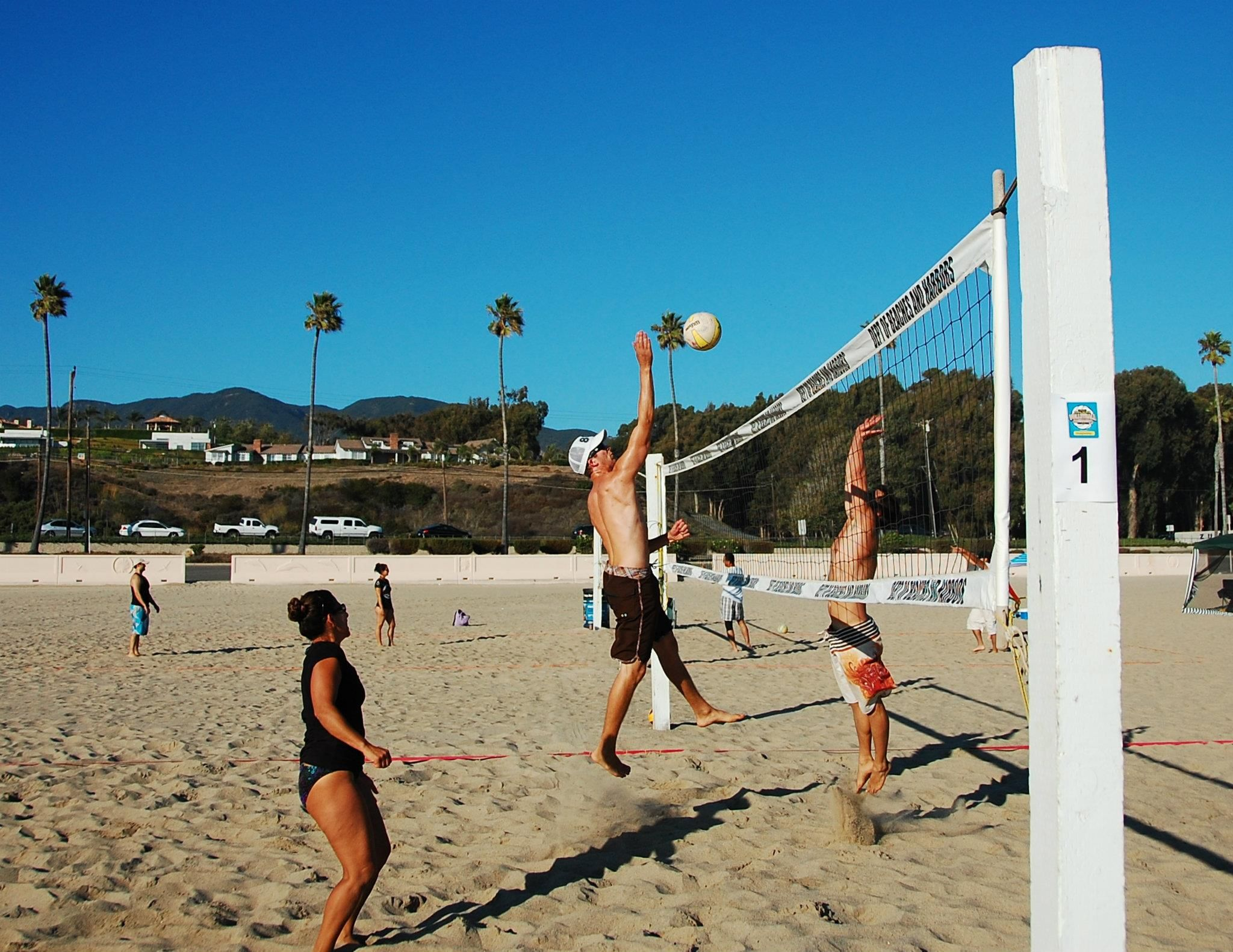 Justin From Media Planning Prepares To Spike During An Intense Game Of Beach Volleyball Here In Beautiful Santa Mon Intense Games Beach Volleyball Santa Monica