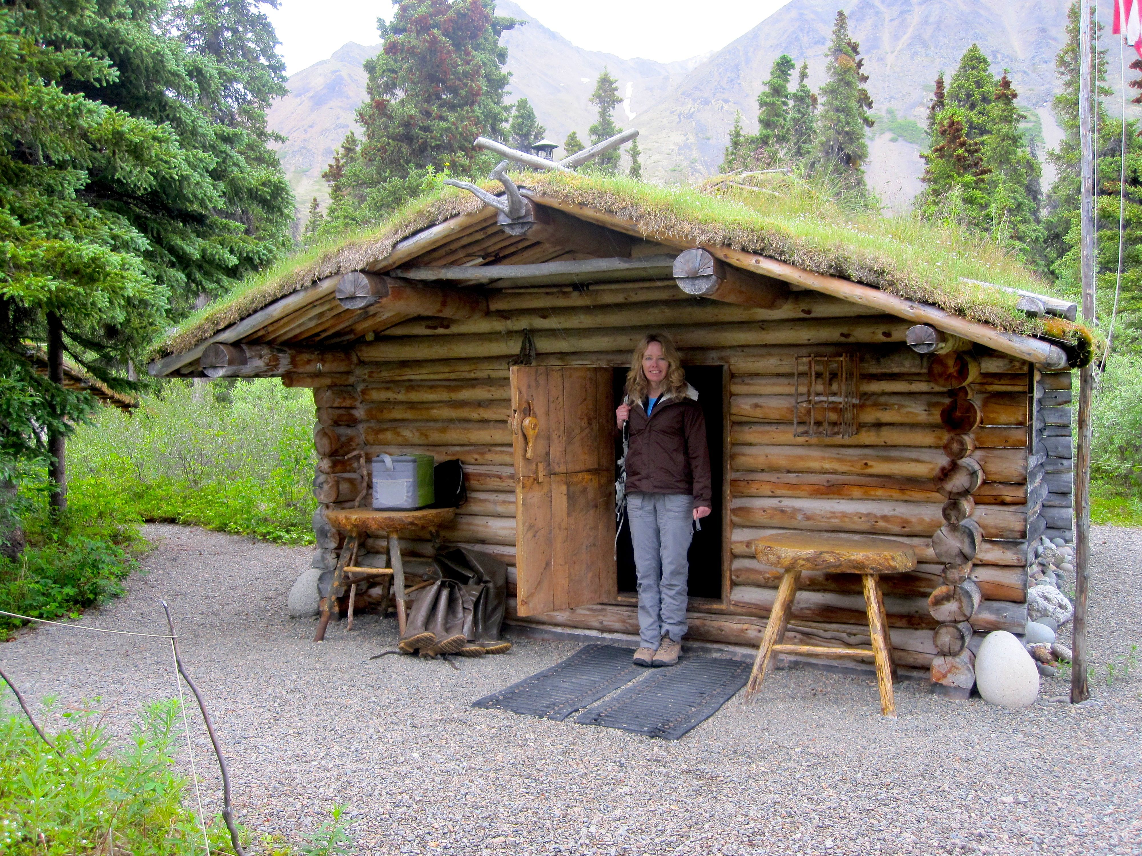 Karen in front of dick proenneke 39 s legendary cabin on twin for Alaska cottage