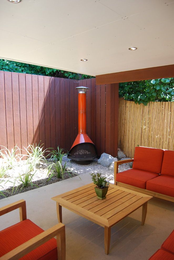 Fire Engine Red With Bamboo Fence Concrete Covered Patio Cushions Deck Fence  Fire Pit Firepit Fireplace